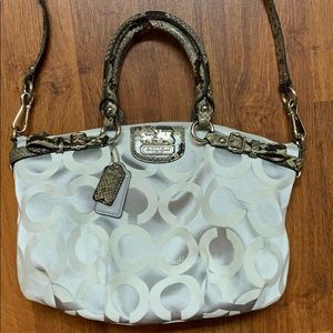 Silver Coach handbag with snake skin strap
